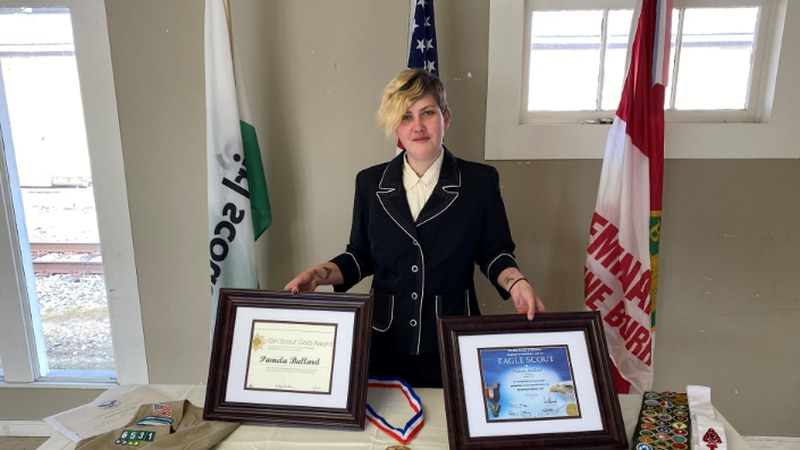 Pamela Bullard and her collection of awards from the Boy Scouts and Girl Scouts.