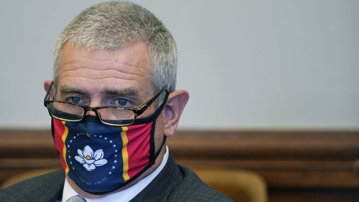 Speaker Philip Gunn, R-Clinton, wears a new state flag face mask during a meeting of the House...