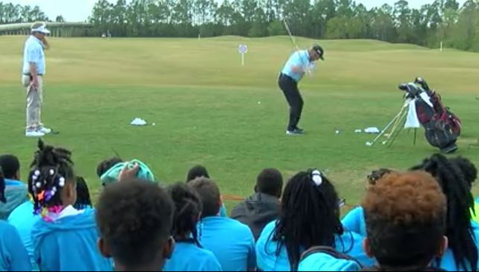 A group of kids watch on as PGA pro Gary Nicklaus, son of famed golfer Jack Nicklaus, shows...