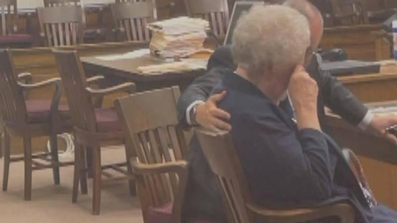 Lavetta Langdon sits next to her attorney, Brian Davis, after being sentenced.