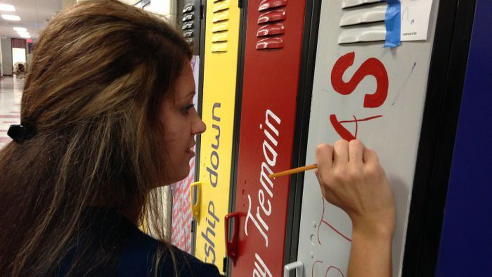 """Teachers and other volunteers have turned one hallway at the school into an """"Avenue of..."""
