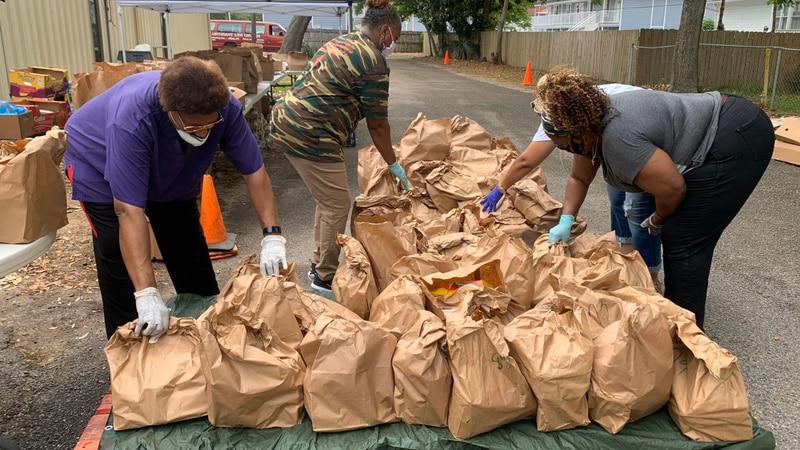 Volunteers giving away food at Abundant Life Evangelistic Center in Biloxi