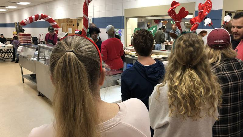 Loaves and Fishes and a group of volunteers served a Christmas Day lunch to Biloxi's homeless...