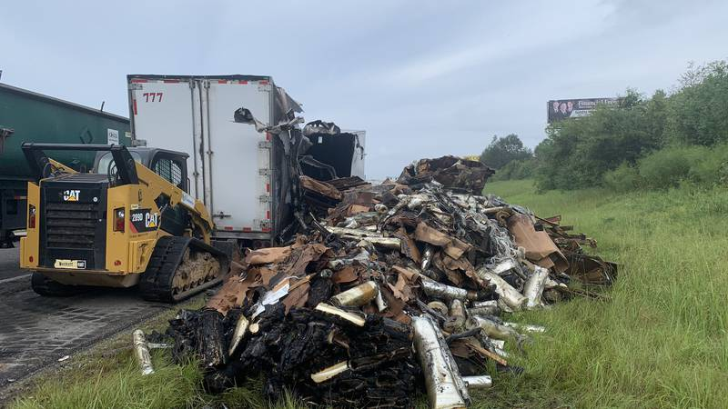 Authorities are working to clear the scene after an 18-wheeler caught fire just before the...