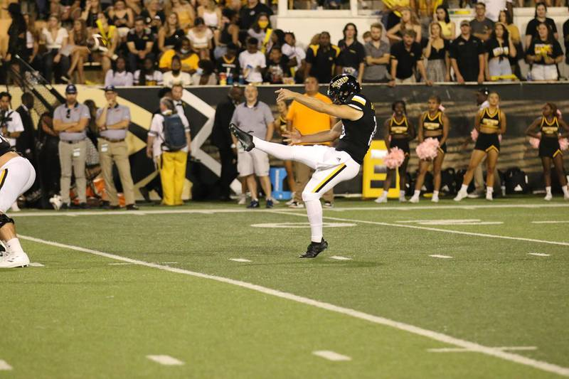Mason Hunt launches a punt against UTEP.