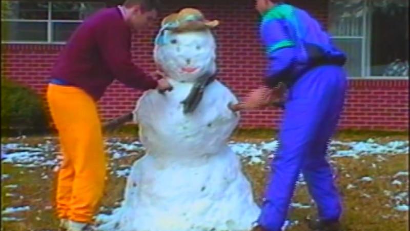 South Mississippians build a snowman after a rare March snow