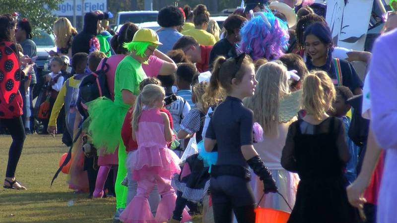 Ocean Springs High students handed out candy to hundreds of elementary students at the...