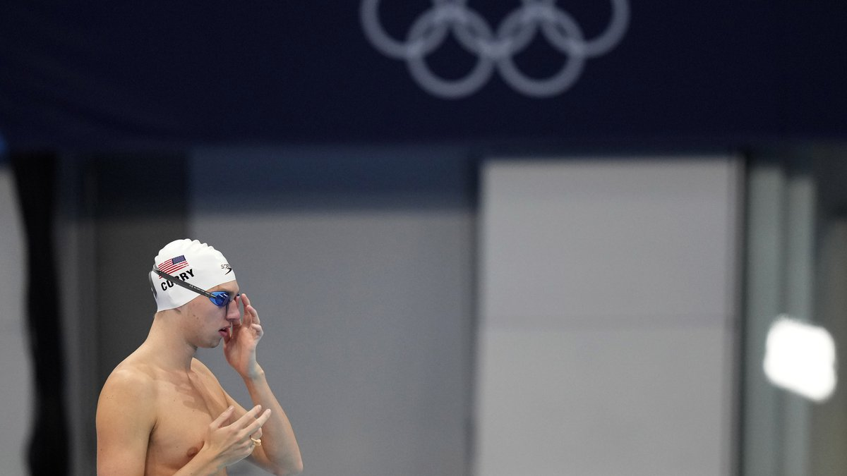 Brooks Curry of the United States starts for a swimming practice session at the Tokyo Aquatics...
