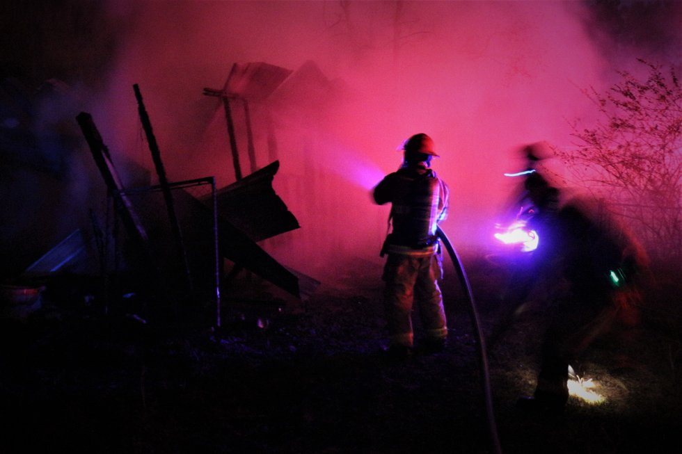 Fire fighters putting out a storage building fire. (Photo source: Pat Sullivan)