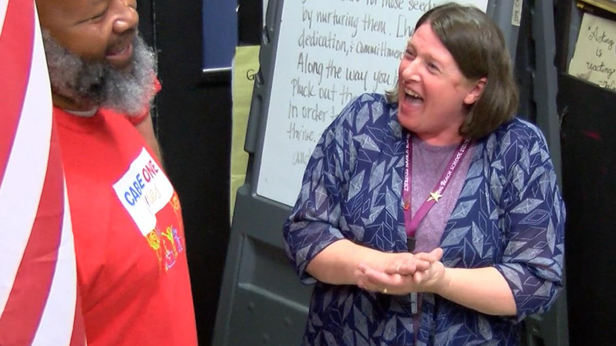 Long Beach High School theater teacher Carrie Ferguson-Bellew, right, thanks a Cable One...