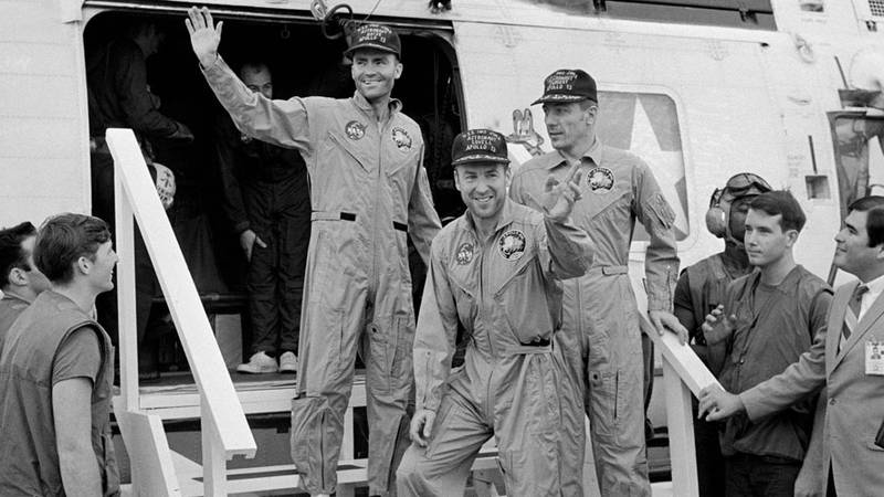 he crewmembers of the Apollo 13 mission, step aboard the USS Iwo Jima, prime recovery ship for...