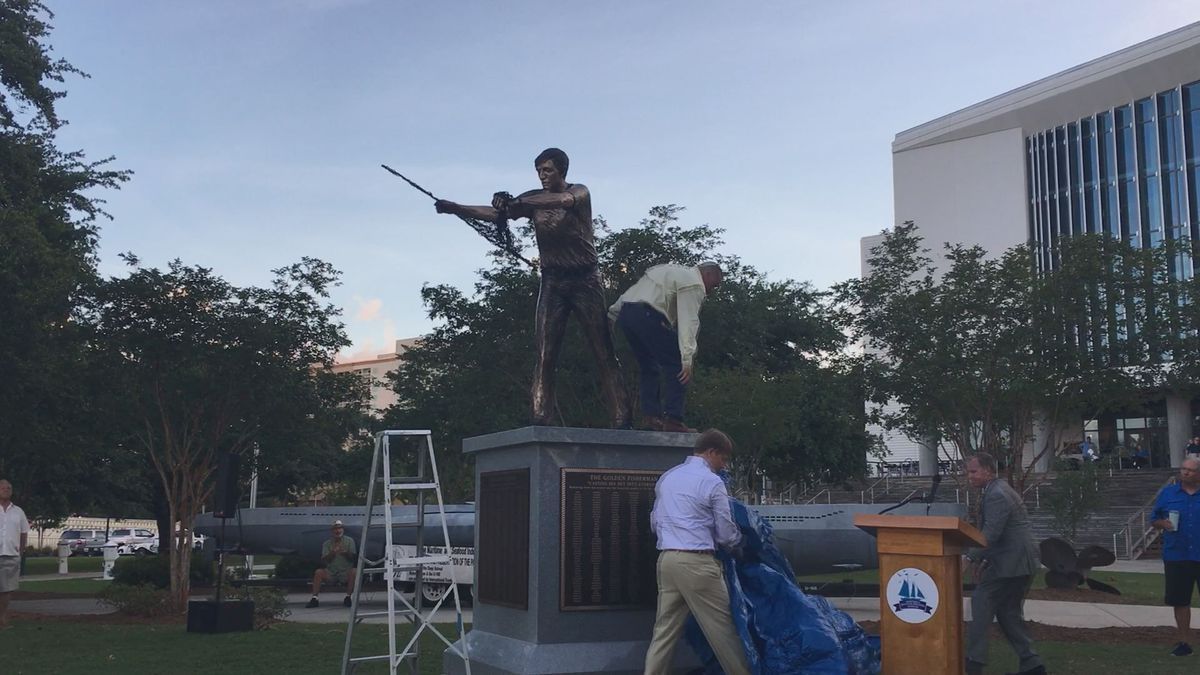 The Golden Fisherman statue was unveiled Thursday night outside the Maritime and Seafood...