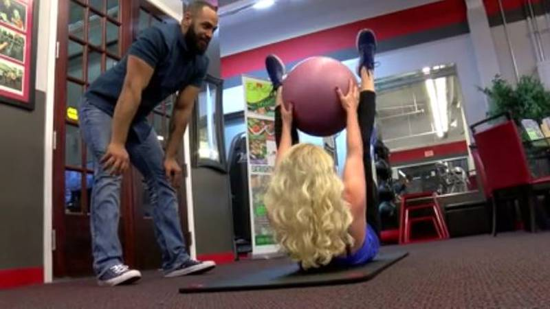 Personal trainer Anthony Anderson works with Audrey Bush to help her keep her fitness goals.