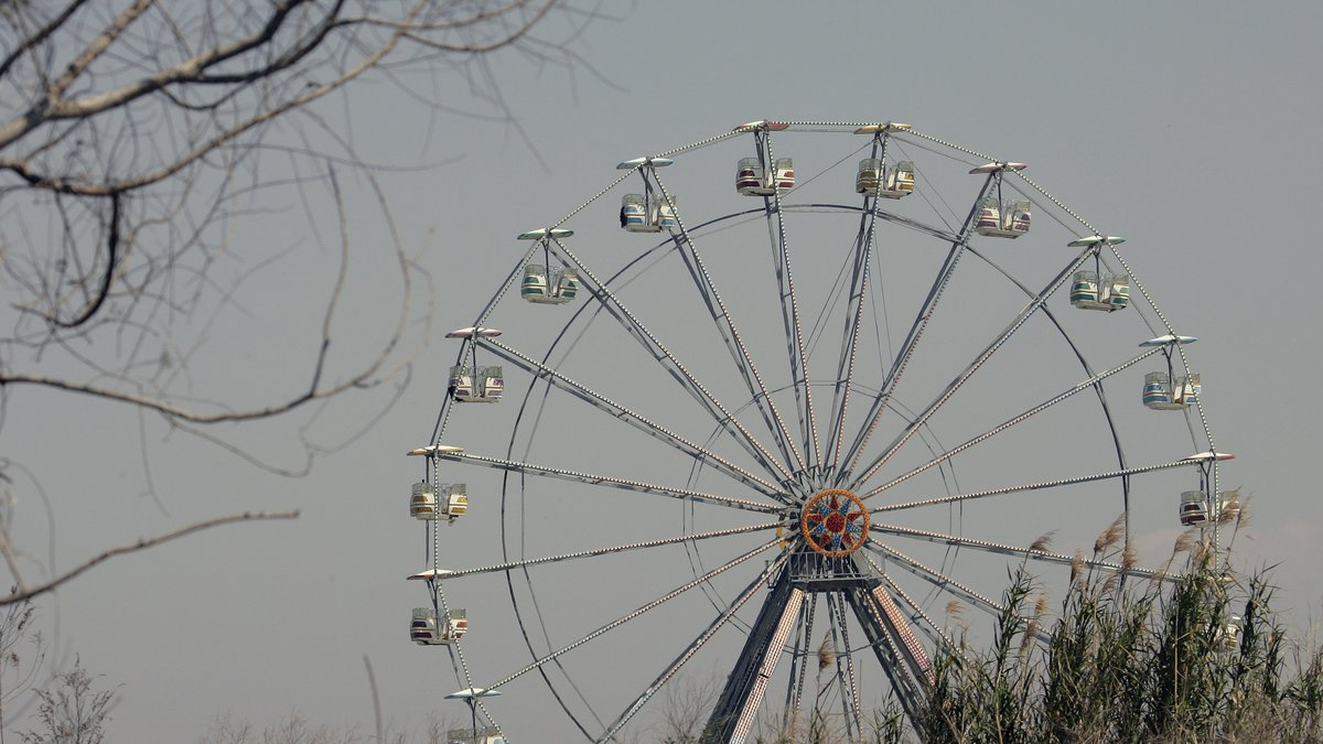 The Ferris wheel sits idle at the Six Flags New Orleans theme park in Eastern New Orleans,...