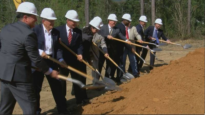Dignitaries have the second ceremonial ground-breaking at the site for the Mississippi Veterans...