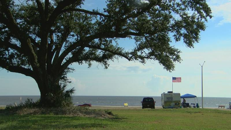Walter Crump's trailer sits near a large oak tree in Biloxi. From there he and his friend will...