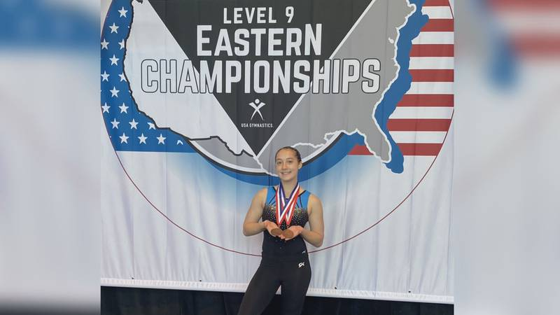Lizzy Janssen poses with her medals at Eastern Nationals