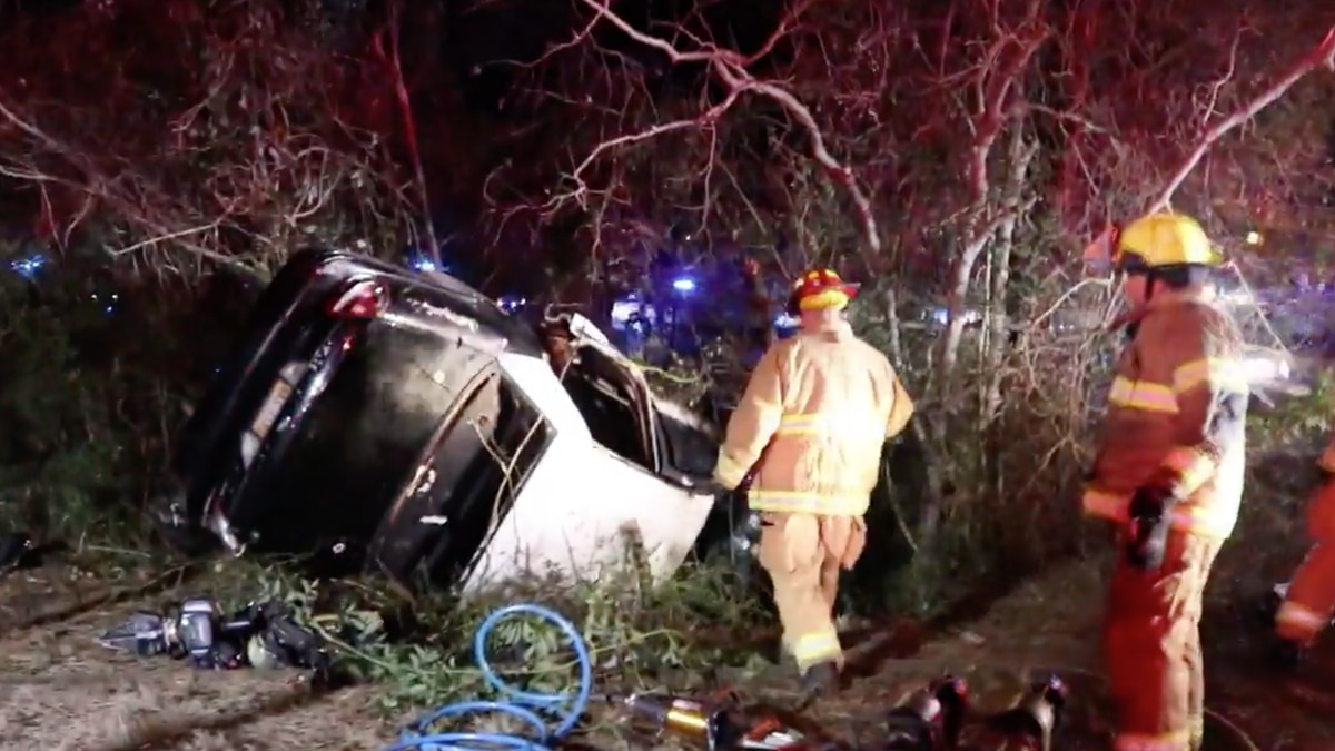 A woman is hospitalized with serious injuries after her car went up in flames on Tuesday.
