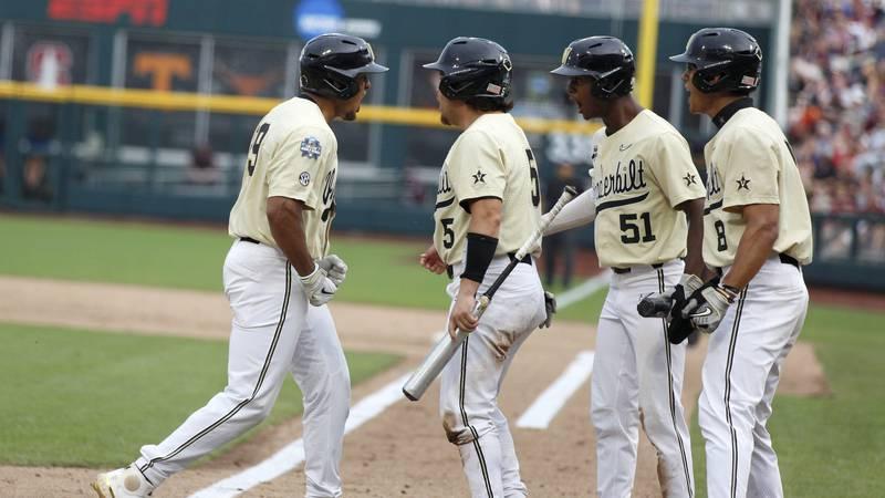 Vanderbilt's Jayson Gonzalez, left, celebrates with teammates after hitting a home run during...