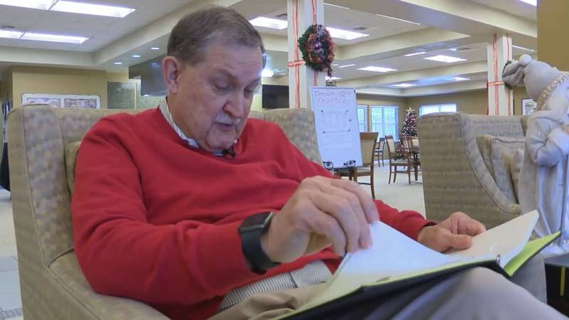 Dave Vincent thumbs through the directory he created at Seashore Highlands retirement home in...