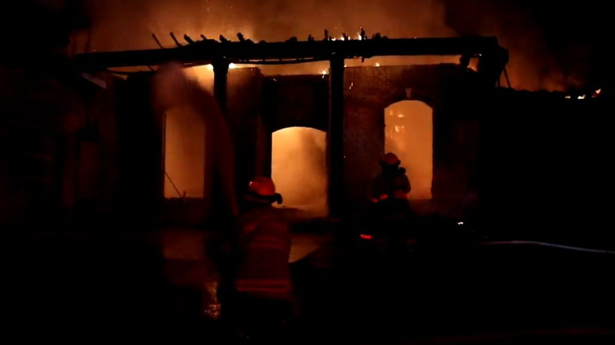 Fire teams from multiple agencies battle an overnight fire in the Oaks subdivision near Menge...