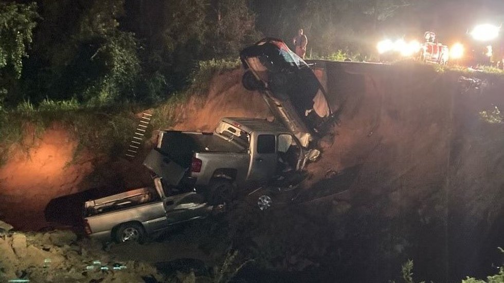 Two people are confirmed dead and 10 are injured after Hwy. 26 in George County washed out...