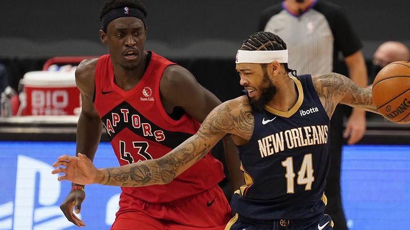 New Orleans Pelicans forward Brandon Ingram (14) works against Toronto Raptors forward Pascal...