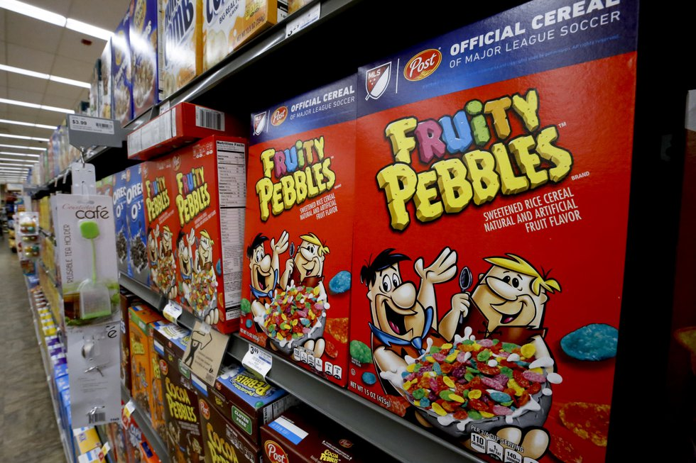 Boxes of Post Fruity Pebbles cereal sit on display in a market in Pittsburgh, Wednesday, Aug....