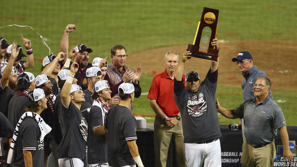 Mississippi State head coach Chris Lemonis lifts the NCAA championship trophy after winning the...