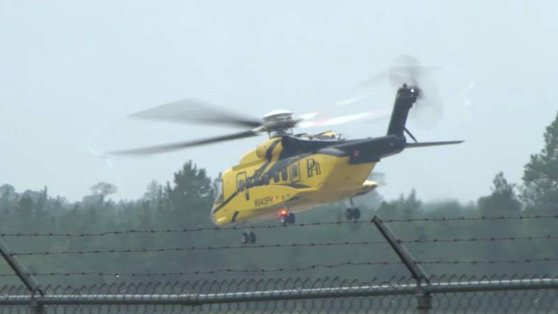 Despite the rain and low clouds, it's business as usual at Stennis International Airport. On...