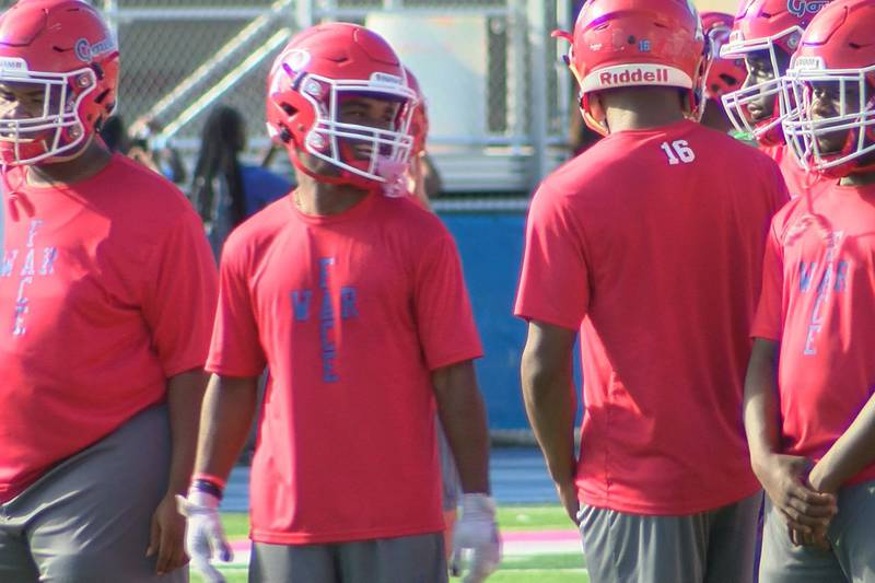 Houston Johnson and his Pascagoula teammates share a laugh during football practice