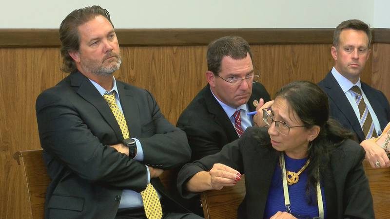 State Sen. Scott Delano, left, and State Rep. Kevin Felsher listen Wednesday as Harrison County...