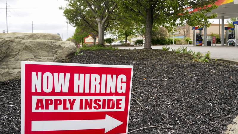 Hiring signs are posted outside a gas station in Cranberry Township, Butler County, Pa.,...
