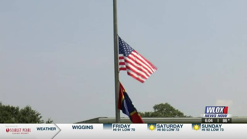 On the first day of school for the new year, flags fly at half-staff at Picayune Memorial High,...
