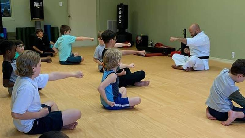 John Miller is living out his childhood dream to open a dojo and teach martial arts to children...