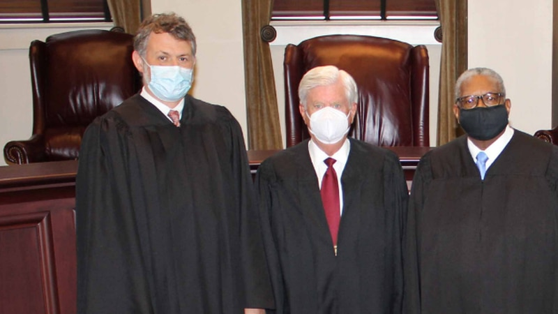 Justice Josiah Coleman (left), Chief Justice Mike Randolph (center) and Presiding Justice...