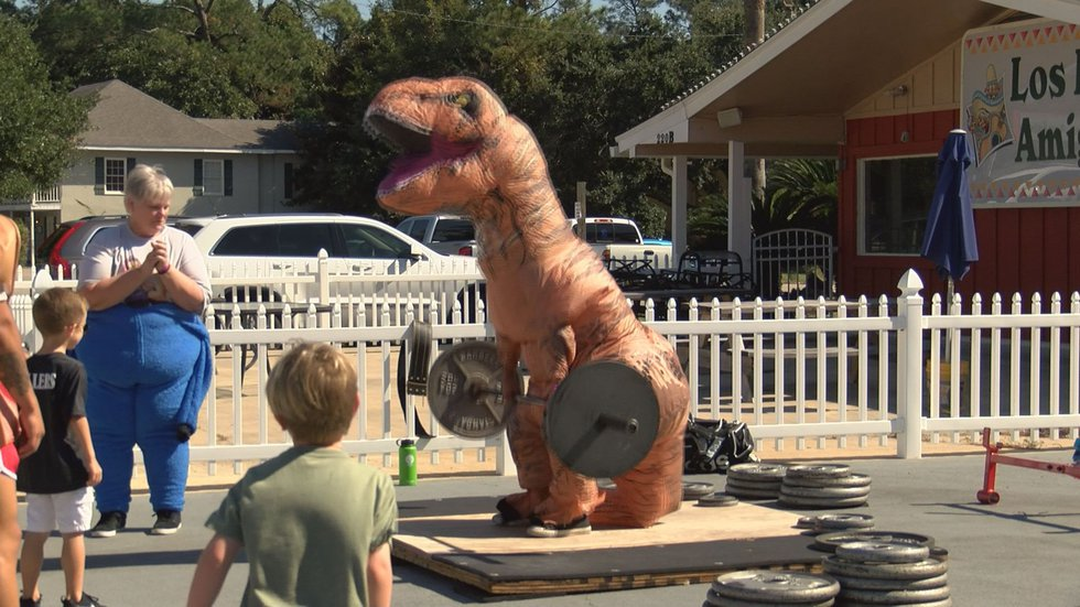 Costume themed weightlifting raises money for breast cancer awareness