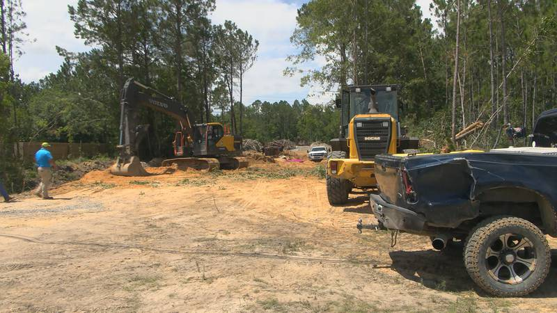 Crews work to clear land at one of the entrances to Gautier's Town Commons Park