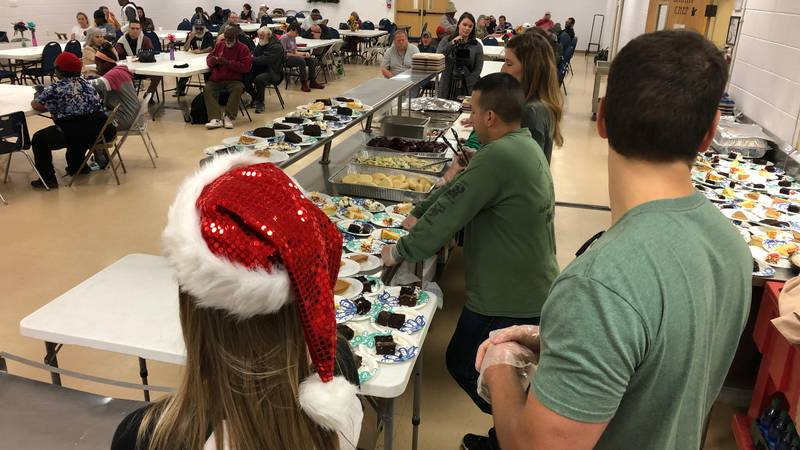 Volunteers from Keesler Air Force Base and the Seabee Base served a Christmas feast to homeless...