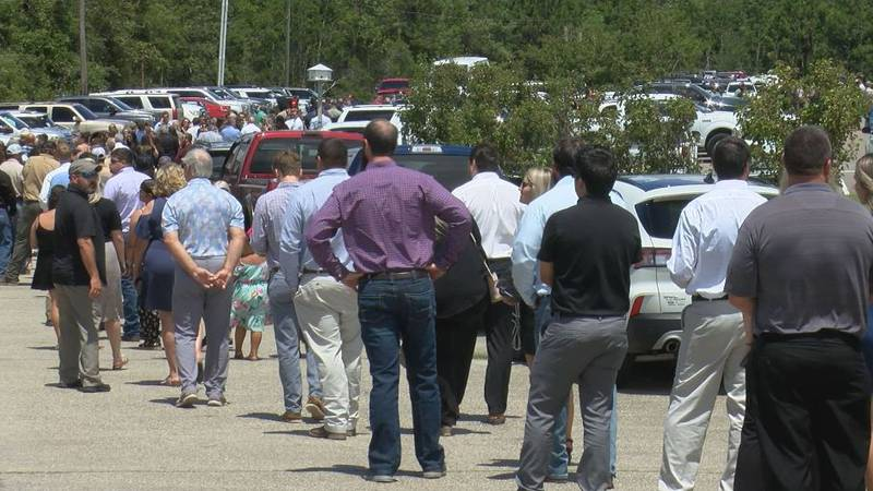 The service for Cayce Seal drew hundreds from throughout the region at St. Clare Catholic...