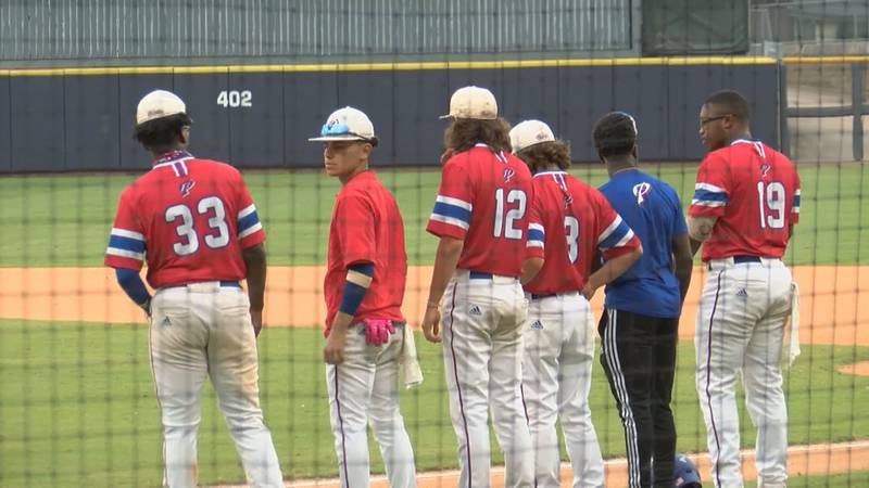 Pascagoula's baseball team lines up before taking on Saltillo in game one of the state...