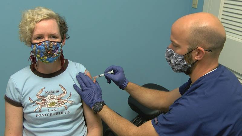 Maureen Bacon of Gulfport gets her first dose of the Moderna vaccine Tuesday at Sartin's drug...