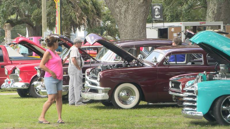 Cars line Beach Park in Pascagoula with their hoods popped open allowing spectators to get a...