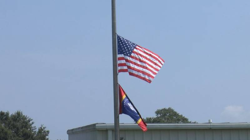 Flags fly at half-staff at Picayune Memorial High on the first day of school, a somber reminder...