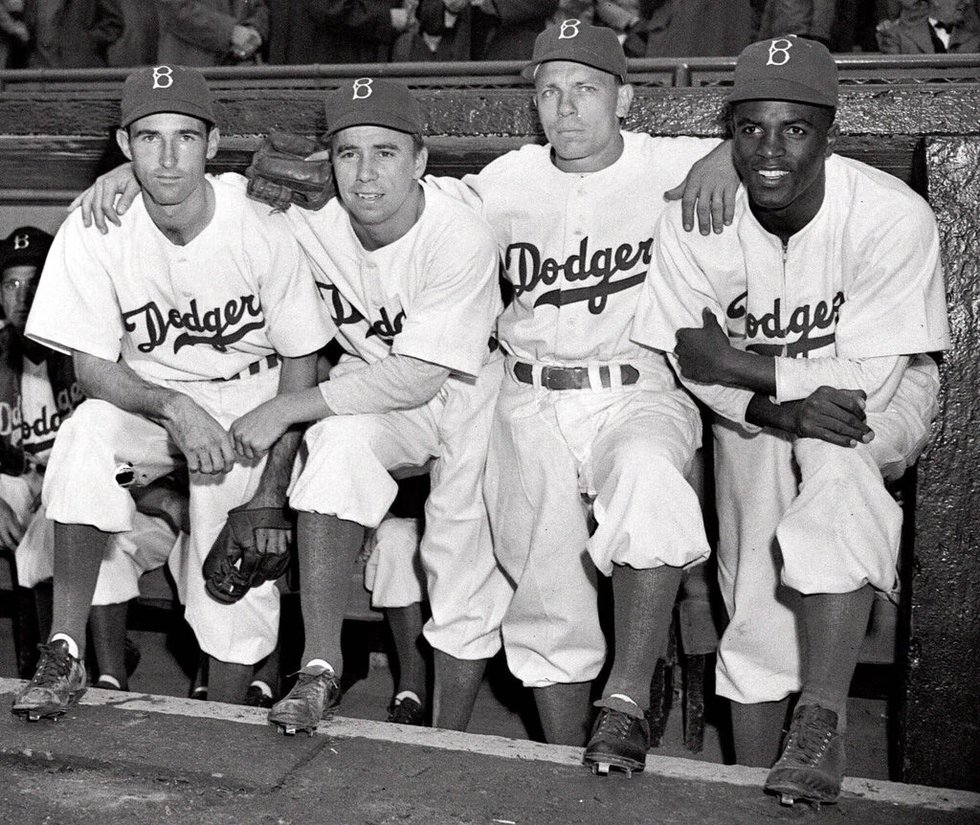 FILE - In this April 15, 1947, file photo, from left, Brooklyn Dodgers baseball players John...