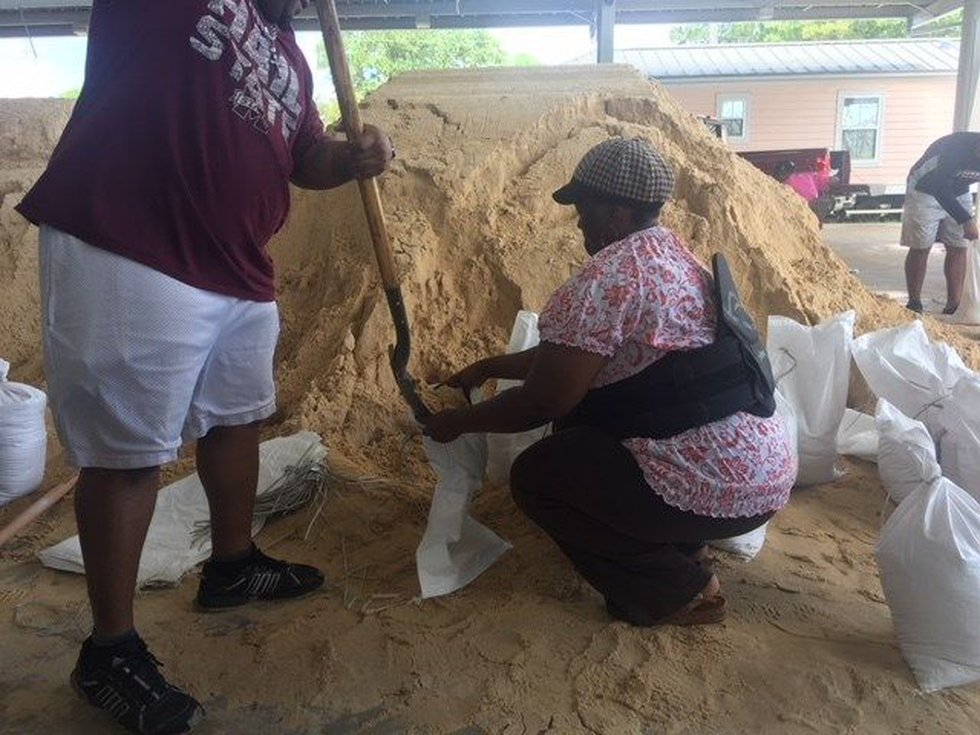 Residents fill sandbags at the fairgrounds in Pascagoula ahead of Gordon (photo source: WLOX)