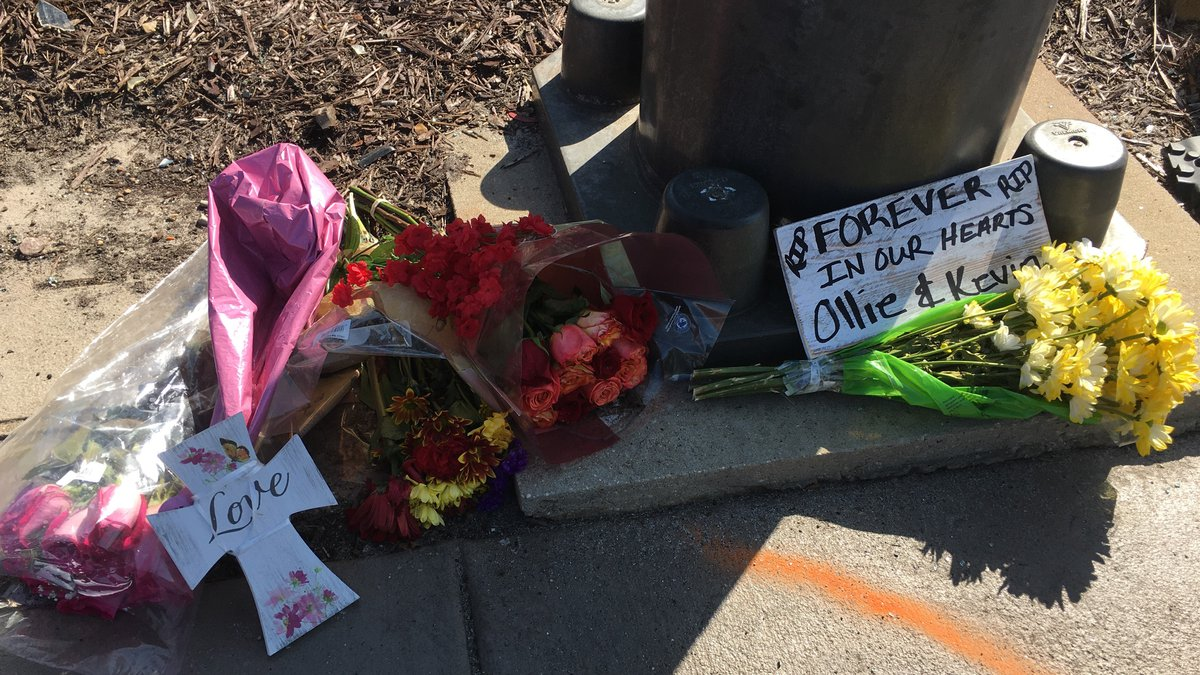 A small memorial sits near a light pole at Highway 90 and Myrtle Street in remembrance of a...