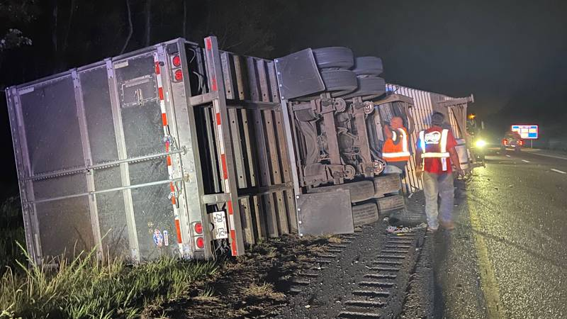 A semi-truck that was hauling flowers overturned on I-10  in Hancock County causing traffic...